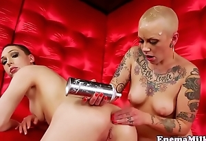 Shorthaired enema babes playing with dildo