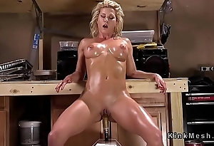 Busty blonde gets fucking machine in ass
