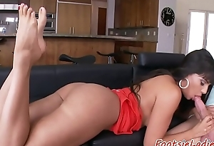 Gorgeous babe gives amazing footjob