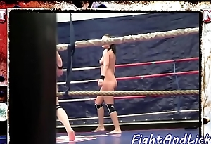 Dyke babes wrestle naked in a boxing ring