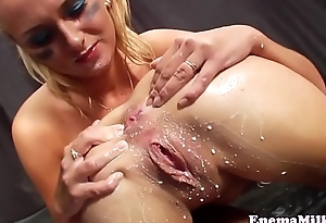 Wam lesbian squirts milk in foreign lands of toyed ass