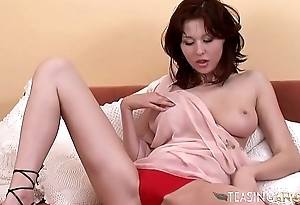She loves teasing you while plunging her pussy with a fake penis